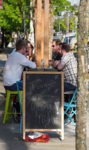 Customers enjoy the outdoor seating at Forge. Photo by Carl Jameson