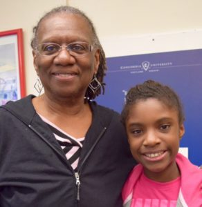 Jane Mayes, pictured here with her granddaughter, is a Ties that Bind navigator. Through the program Mayes offers support to other grandparents raising their grandchildren. Photo by Patience Tolentino.