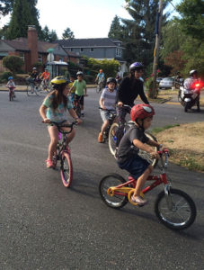 Parade goers took to a variety of vehicles – escorted by Portland Police Bureau motorcycle officers – for the Aug. 2 National Night Out parade.