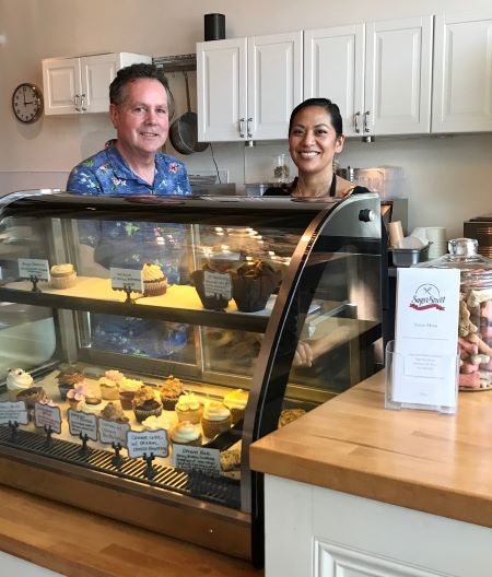 Darrell Hames and Melissa Sanchez stand at the ready to serve snacks, meals and accept catering orders at the new Sugar Street Bakery and Bistro on Alberta Street. Photo by Marsha Sandman
